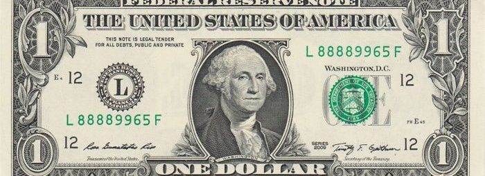 Банкнота в один доллар, на которой изображен Джордж Вашингтон - первый президент Соединенных Штатов - Отец Отечества